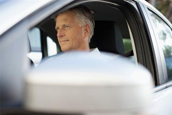 Man driving car, cropped Stock Photo - Premium Royalty-Free, Image code: 632-05816938