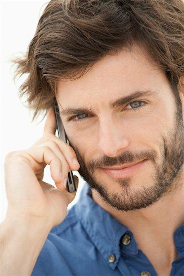 Man using cell phone, portrait Stock Photo - Premium Royalty-Free, Image code: 632-05845221