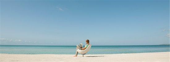 Man reading book at the beach Stock Photo - Premium Royalty-Free, Image code: 632-05845446