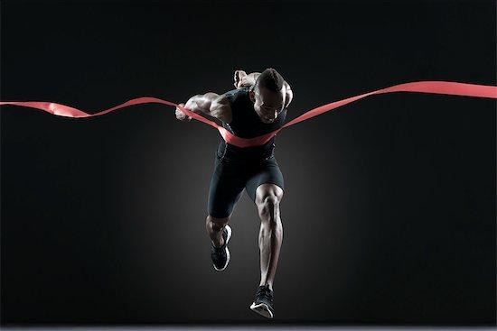 Runner crossing finish line Stock Photo - Premium Royalty-Free, Image code: 632-05845481