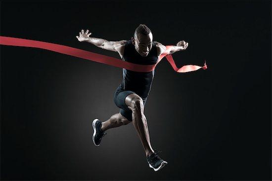 Runner crossing finish line Stock Photo - Premium Royalty-Free, Image code: 632-05845738
