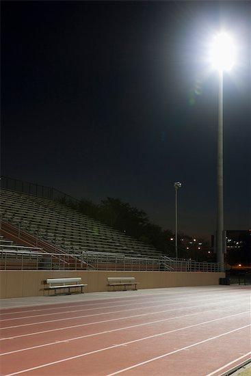 Running track at night Stock Photo - Premium Royalty-Free, Image code: 632-05992129