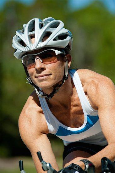 Female cyclist Stock Photo - Premium Royalty-Free, Image code: 632-05992225