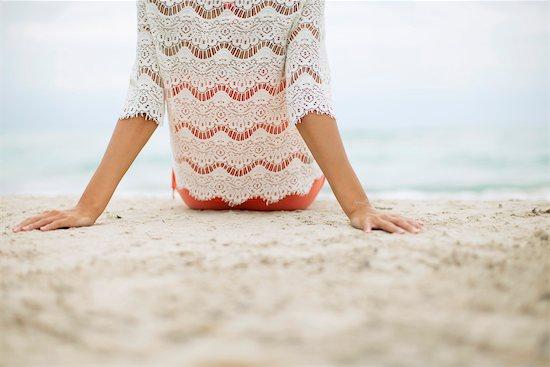 Woman sitting on beach, rear view Stock Photo - Premium Royalty-Free, Image code: 632-05992227
