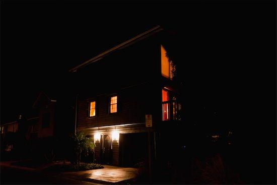 House illuminated at night Stock Photo - Premium Royalty-Free, Image code: 632-06030055