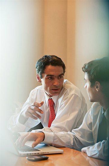 Businessmen in meeting Stock Photo - Premium Royalty-Free, Image code: 632-06118910