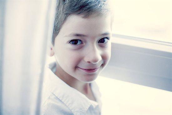 Boy smiling at camera, portrait Stock Photo - Premium Royalty-Free, Image code: 632-06317536
