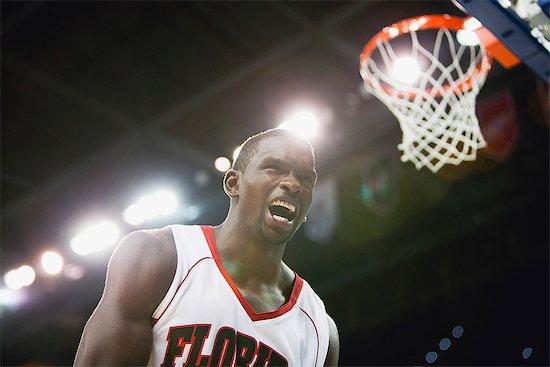 Basketball player shouting Stock Photo - Premium Royalty-Free, Image code: 632-06317580