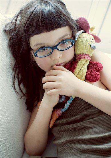 Girl holding stuffed toy, portrait Stock Photo - Premium Royalty-Free, Image code: 632-06317940
