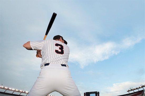 Baseball player preparing to bat, rear view Stock Photo - Premium Royalty-Free, Image code: 632-06318065