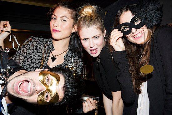 Friends having fun celebrating at party Stock Photo - Premium Royalty-Free, Image code: 632-07809540