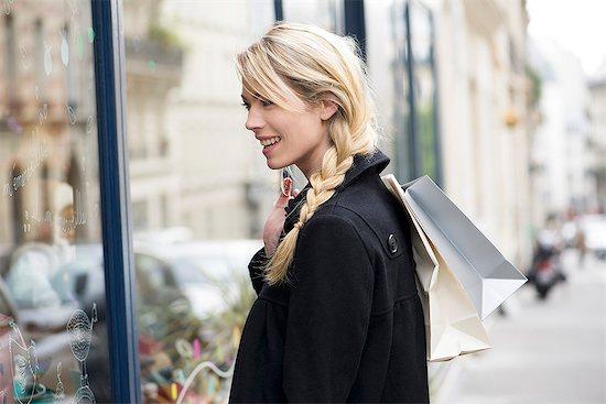 Woman window shopping Stock Photo - Premium Royalty-Free, Image code: 632-07809573