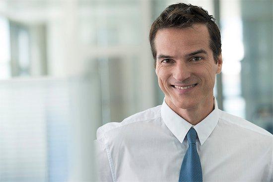 Businessman smiling cheerfully, portrait Stock Photo - Premium Royalty-Free, Image code: 632-08001611