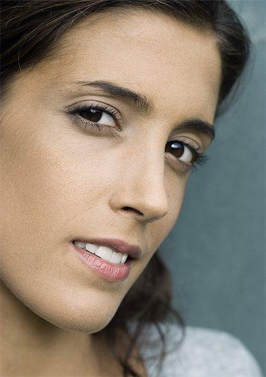 Woman glancing sideways at camera, close-up Stock Photo - Premium Royalty-Free, Image code: 632-08001869