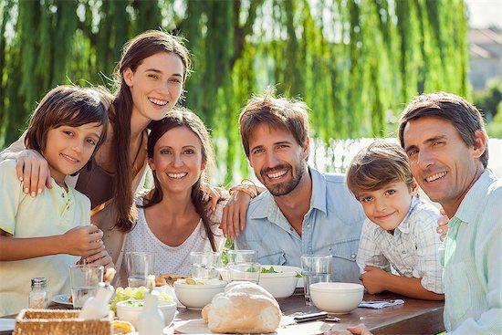 Family enjoying breakfast together outdoors, group portrait Stock Photo - Premium Royalty-Free, Image code: 632-08129728