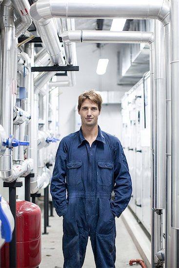Engineer in industrial plant, portrait Stock Photo - Premium Royalty-Free, Image code: 632-08129766
