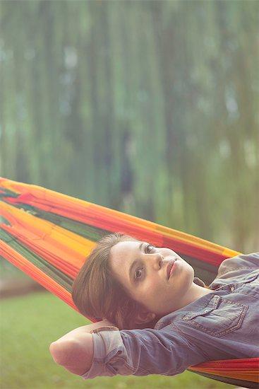 Woman relaxing in hammock Stock Photo - Premium Royalty-Free, Image code: 632-08129763