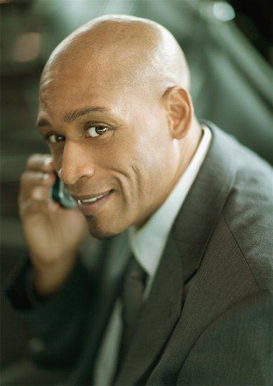 Businessman using cell phone, portrait Stock Photo - Premium Royalty-Free, Image code: 632-01157684