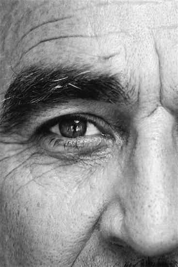 Mature man, looking at camera, close-up of eye, black and white Stock Photo - Premium Royalty-Free, Image code: 632-02064278