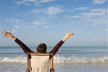 504dd7b8c9 Deck chair beach back men Stock Photos - Page 1 : Masterfile
