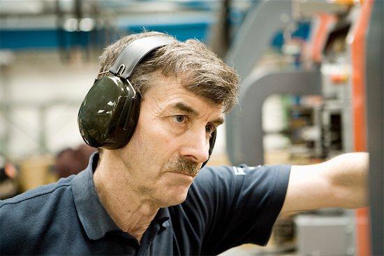 Factory worker wearing protective headphones Stock Photo - Premium Royalty-Free, Image code: 632-03754595