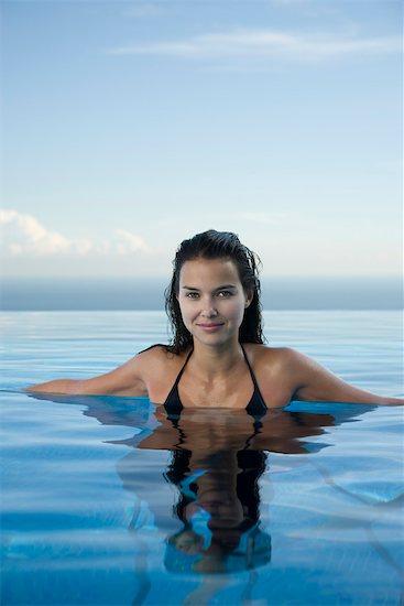 Woman swimming, portrait Stock Photo - Premium Royalty-Free, Image code: 632-03779632