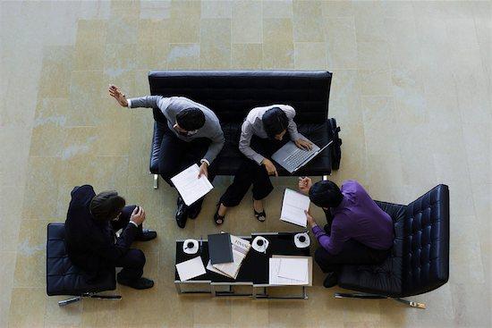 Executives having meeting, overhead view Stock Photo - Premium Royalty-Free, Image code: 632-03847814