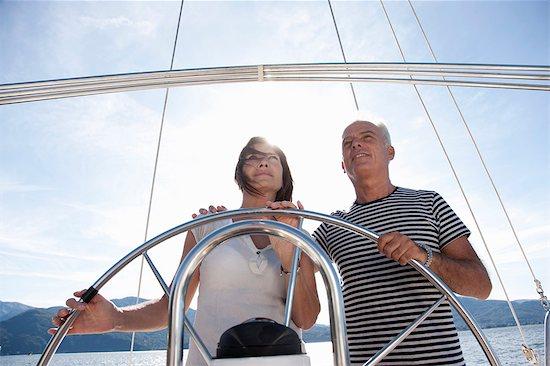 Older couple sailing together Stock Photo - Premium Royalty-Free, Image code: 649-05521013