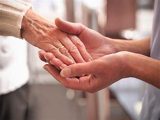 Nurse holding older mans hand Stock Photo - Premium Royalty-Free, Image code: 649-05801983