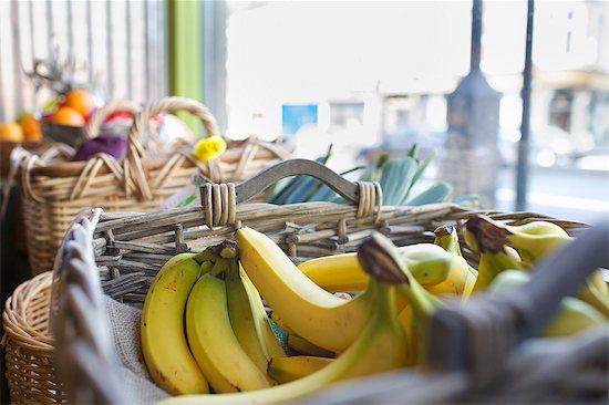 Close up of basket of bananas Stock Photo - Premium Royalty-Free, Image code: 649-06041038