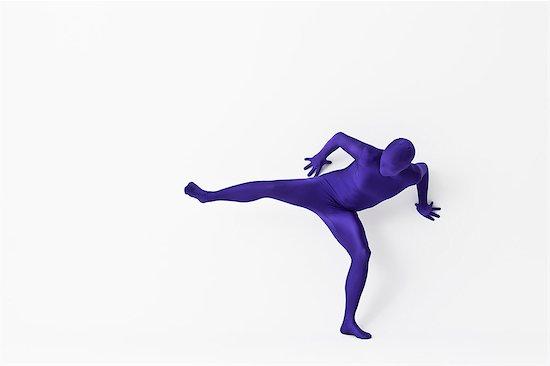 Man in bodysuit posing Stock Photo - Premium Royalty-Free, Image code: 649-06041658