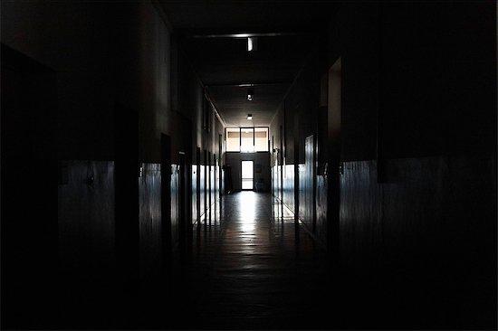 Light shining from door in dark hallway Stock Photo - Premium Royalty-Free, Image code: 649-06622989