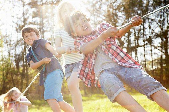 Children playing tug o war Stock Photo - Premium Royalty-Free, Image code: 649-07063048