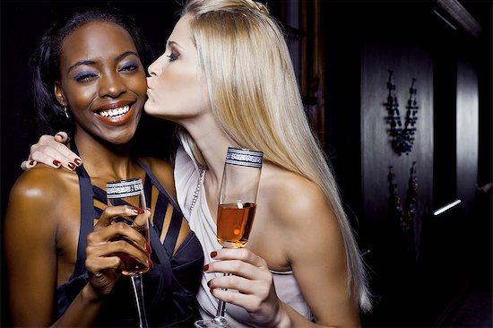 Two female friends hugging in nightclub Stock Photo - Premium Royalty-Free, Image code: 649-07118902