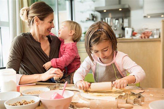 Girl baking in kitchen Stock Photo - Premium Royalty-Free, Image code: 649-07280357
