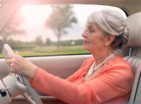 Elegant senior woman driving in car Stock Photo - Premium Royalty-Free, Image code: 649-07520293