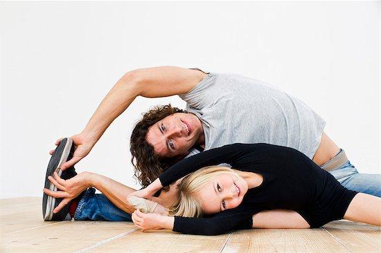 Studio shot of father and ballerina daughter doing splits Stock Photo - Premium Royalty-Free, Image code: 649-07520621