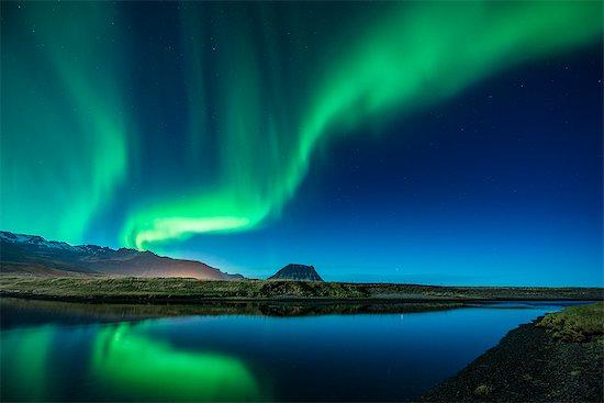 Aurora Borealis above Grundarfjordur, Mt. Kikjufell in centre, Snaefellsnes, Iceland Stock Photo - Premium Royalty-Free, Image code: 649-07760948