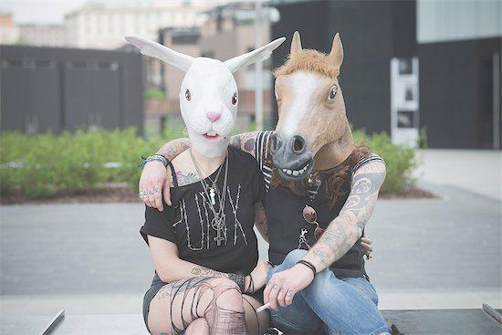Portrait of punk hippy couple wearing rabbit and horse costume masks Stock Photo - Premium Royalty-Free, Image code: 649-08060323