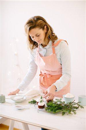 woman decorating chocolate cupcakes stock photo premium royalty free code 649