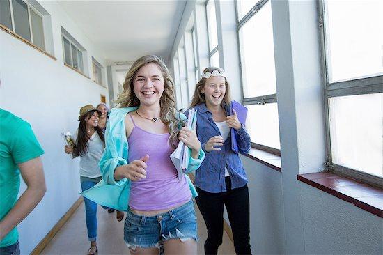Students running down hallway, laughing Stock Photo - Premium Royalty-Free, Image code: 649-08238292