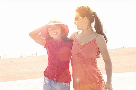 Mid adult woman and daughter at beach, Zhuhai, Guangdong, China Stock Photo - Premium Royalty-Free, Image code: 649-08307173