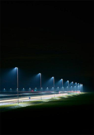 Night shot of new road build on land reclaimed from sea, Rotterdam harbor, Massvlakte, Rotterdam, Netherlands Stock Photo - Premium Royalty-Free, Image code: 649-08565604