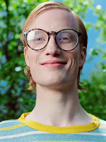 Smiling man wearing eyeglasses Stock Photo - Premium Royalty-Free, Image code: 649-08560718