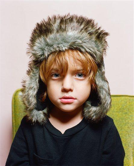 Boy wearing fur hat Stock Photo - Premium Royalty-Free, Image code: 649-08563671