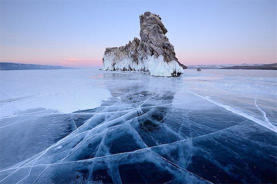 Ice and Ogoy Island, Baikal Lake, Olkhon Island, Siberia, Russia Stock Photo - Premium Royalty-Free, Image code: 649-08661140