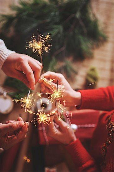 Couple holding indoor sparklers Stock Photo - Premium Royalty-Free, Image code: 649-08969052