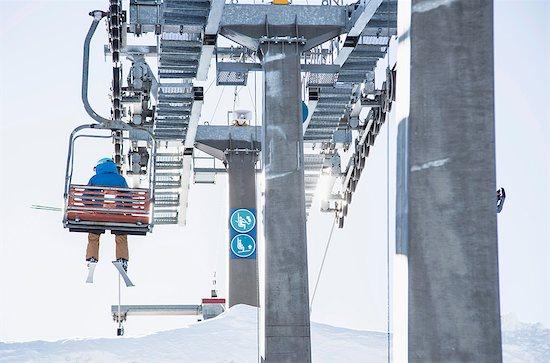 Skier on ski lift, rear view Stock Photo - Premium Royalty-Free, Image code: 649-09078188