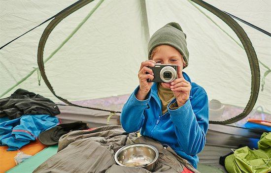 Boy sitting in tent, looking at camera, Ventilla, La Paz, Bolivia, South America Stock Photo - Premium Royalty-Free, Image code: 649-09123328