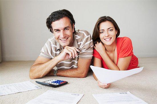 Couple work on home finance Stock Photo - Premium Royalty-Free, Image code: 649-02055414